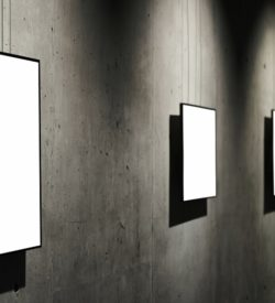 Empty white isolated frame on the wall
